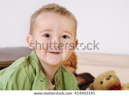 portrait of little cute smiling child boy with his toy, happy childhood concept, happy child - stock photo