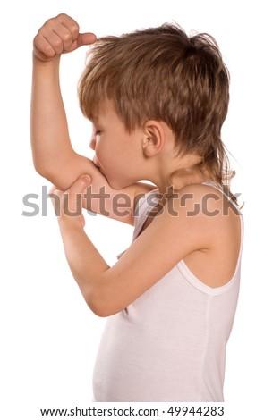 Portrait of little european boy flexing biceps. Beautiful caucasian model. Isolated on white background. - stock photo