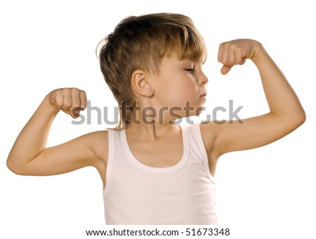 Portrait of little european boy flexing biceps. Isolated on white background.