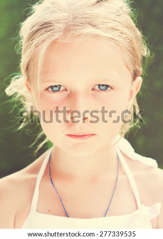 Portrait of Little Fair Haired Girl with Blue Eyes. Toned  - stock photo