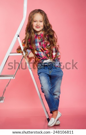 Portrait of little fashion girl. Picture of a funny little girl. studio shot. - stock photo