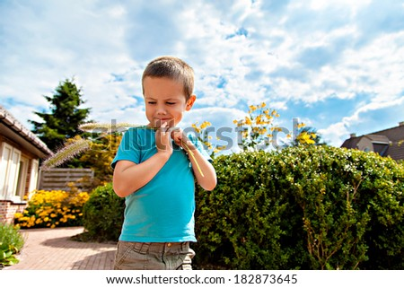 Portrait of little funny boy outdoors - stock photo