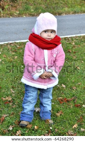 Portrait of little girl against autumn nature - stock photo