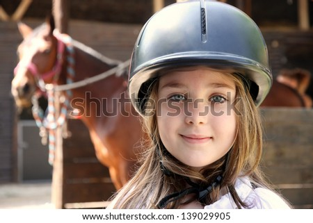Portrait of little girl and brown Horse - stock photo