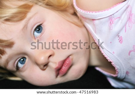 portrait of little girl before she falling asleep