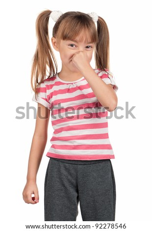 Portrait of little girl covering nose with hand over white background - stock photo