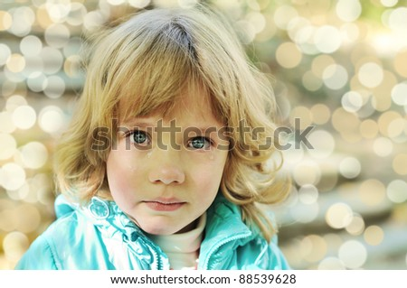 Portrait of little girl crying with true tears - stock photo