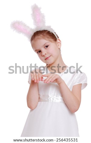 Portrait of little girl dressed in Easter bunny ears on white background - stock photo