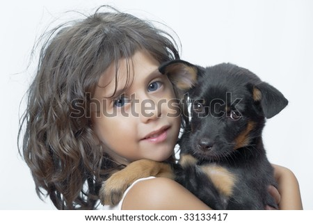 Portrait of little girl having good time with her puppy - stock photo