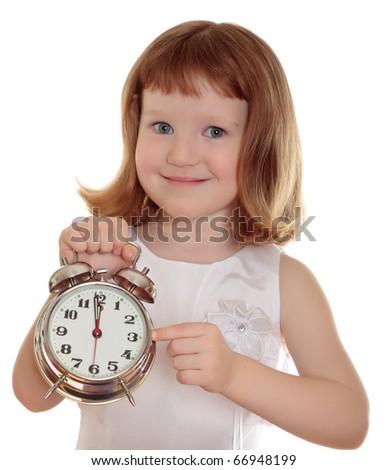Portrait of little girl holding alarm clock, isolated over white - stock photo