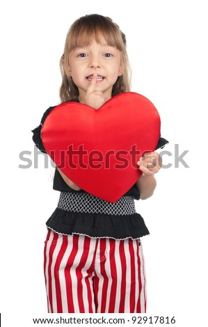 Portrait of little girl holding red heart with silence gesture over white background - stock photo