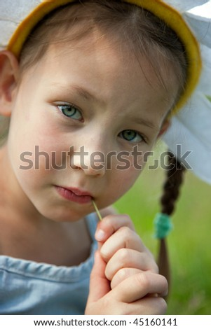 "Portrait of little girl in a costume ""camomile"" - stock photo"