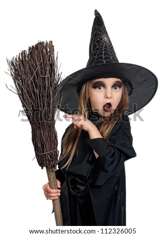 Portrait of little girl in black hat and black clothing with broom on white background - stock photo