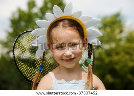 Portrait of little girl in camomile hat - stock photo