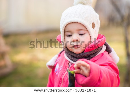 Portrait of little girl in spring cold day