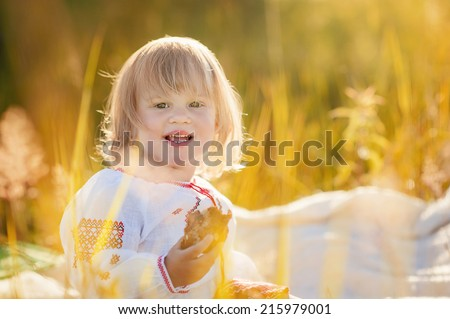 portrait of little girl in the field
