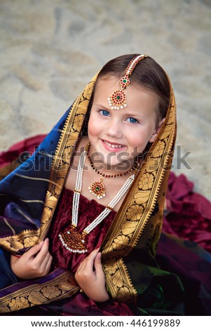 Portrait of little girl in traditional indian sari - stock photo