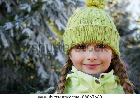 Portrait of little girl in winter forest - stock photo