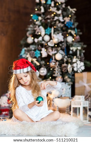 Portrait of little girl near christmas tree