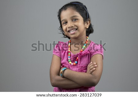 Portrait of little girl of Indian origin with a smiling face  - stock photo