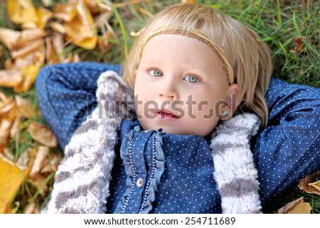 portrait of little girl outdoors in autumn