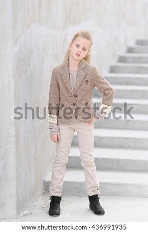 portrait of little girl outdoors in autumn - stock photo