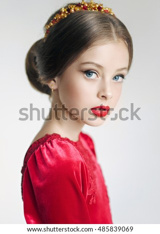 portrait of little girl outdoors in red