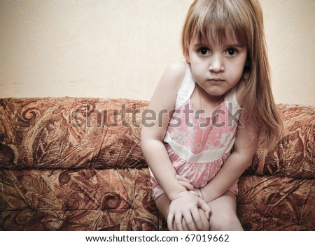 Portrait of little girl playing and imagine she is a model - stock photo