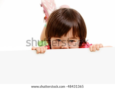 Portrait of little girl playing hide and seek - stock photo