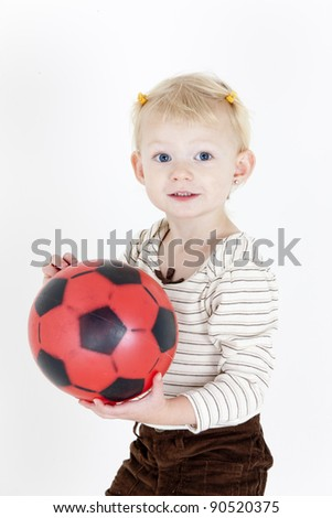 portrait of little girl playing with a ball - stock photo