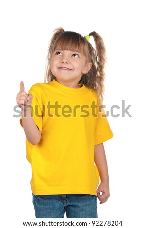 Portrait of little girl pointing up over white background