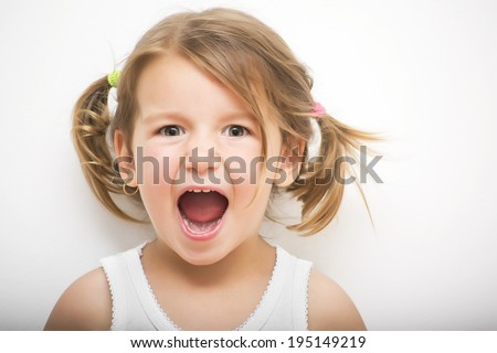 Portrait of little girl screaming - stock photo