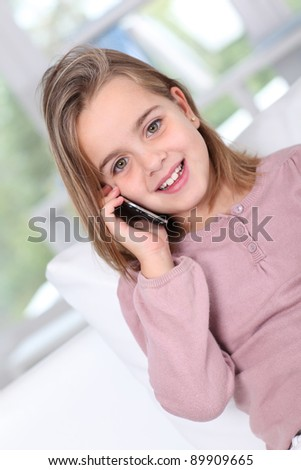 Portrait of little girl talking on mobile phone - stock photo