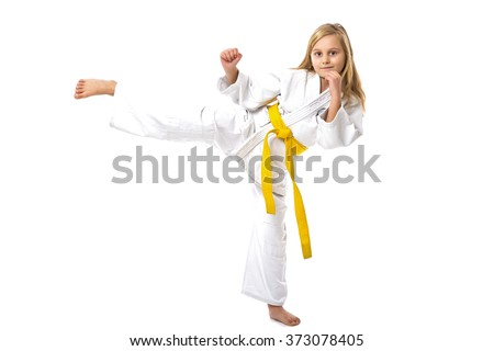 Portrait of little girl training ashihara martial art  isolated on white background - stock photo