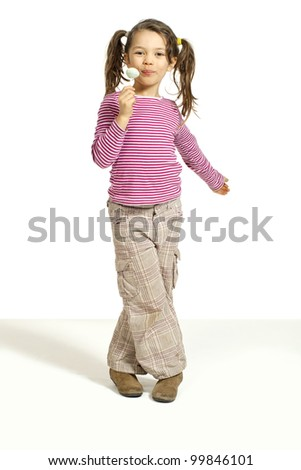 portrait of little girl with a lollipop, isolated on white background - stock photo