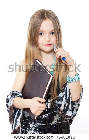 portrait of little girl with a pencil and workbook - stock photo