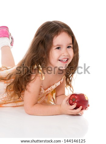 Portrait of little girl with apple, isolated on white background - stock photo