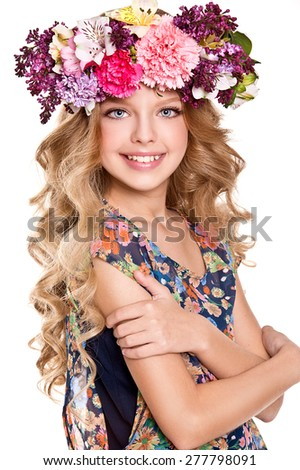Portrait of little girl with flower wreath - stock photo