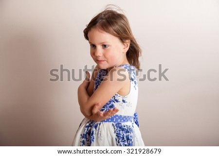 Portrait of little girl with hands crossed in front of her - stock photo