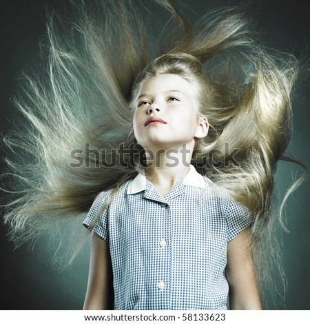 Portrait of little girl with magnificent hair - stock photo