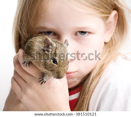 portrait of little girl with mouse in hands isolated on white - stock photo