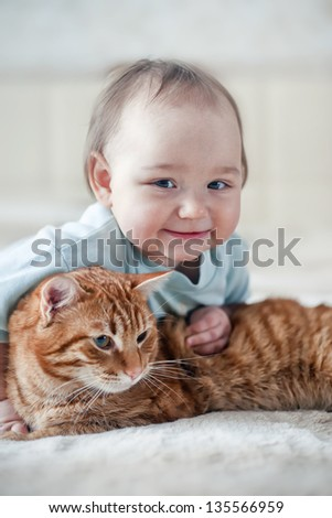 portrait of little girl with red cat - stock photo