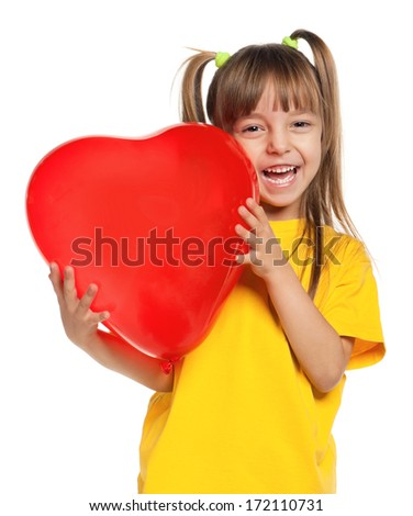 Portrait of little girl with red heart balloon on white background - stock photo