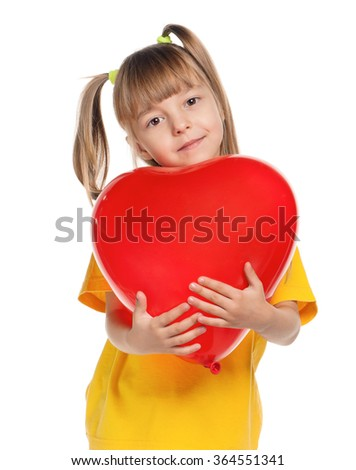 Portrait of little girl with red heart balloon over white background - stock photo