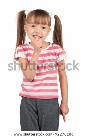Portrait of little girl with silence gesture over white background - stock photo
