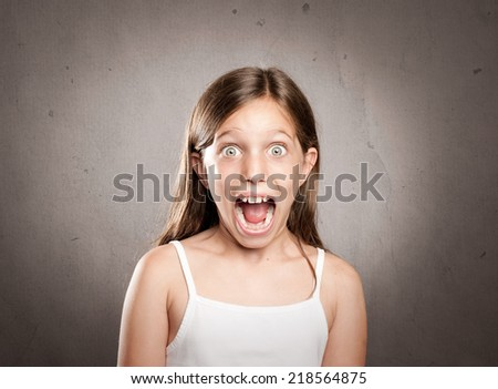 portrait of little girl with surprise expression - stock photo