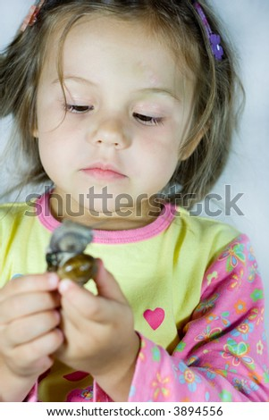 portrait of little girl with the snail