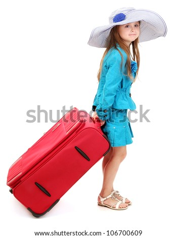 Portrait of little girl with travel case and hat isolated on white