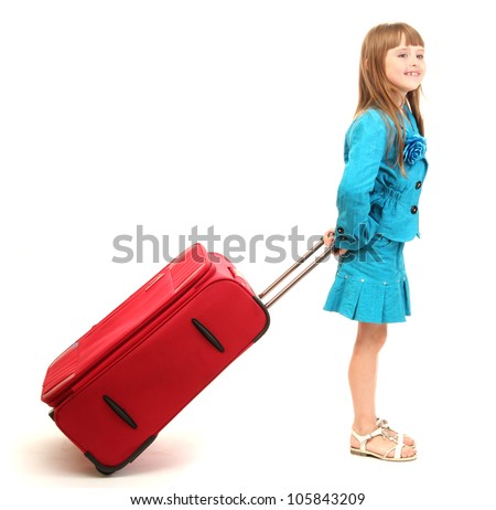 Portrait of little girl with travel case isolated on white