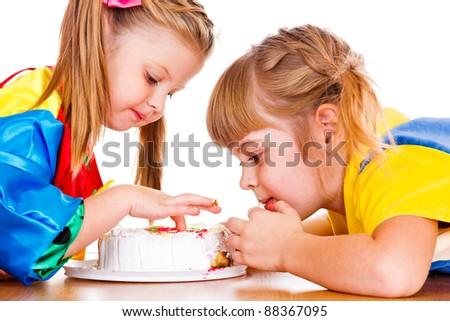 Portrait of little girls eating cake - stock photo